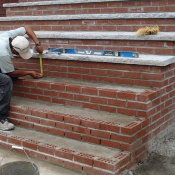 Brick Mason measuring height of Brick Paving Step image